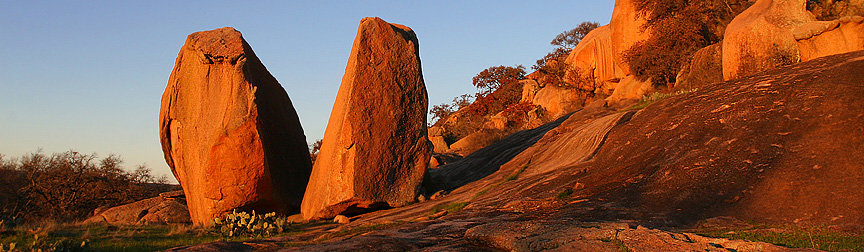 Early morning light illuminates these large boulders at Enchanted Rock. Image #7