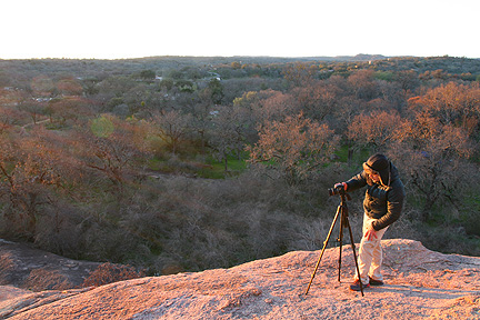 Photographer shoots the sunrise at Enchanted Rock State natural area. Image #5