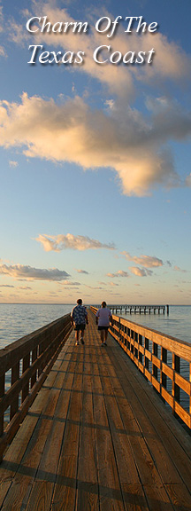 A couple takes a stroll on the pier at Rockport Beach Park