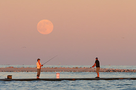 Photo #5, People fishing as the full moon rises, South Jetty Galveston