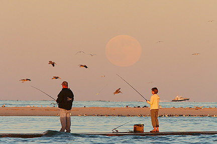 Photo #4, People fishing as the full moon rises, South Jetty Galveston