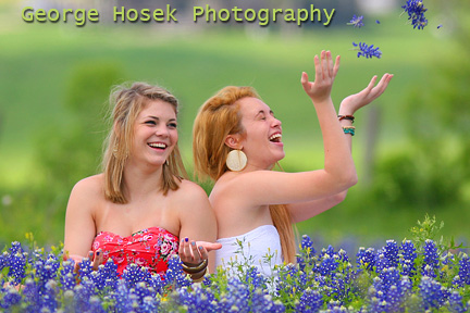 Girls gets their picture taken with Bluebonnets in Brenham Texas.
